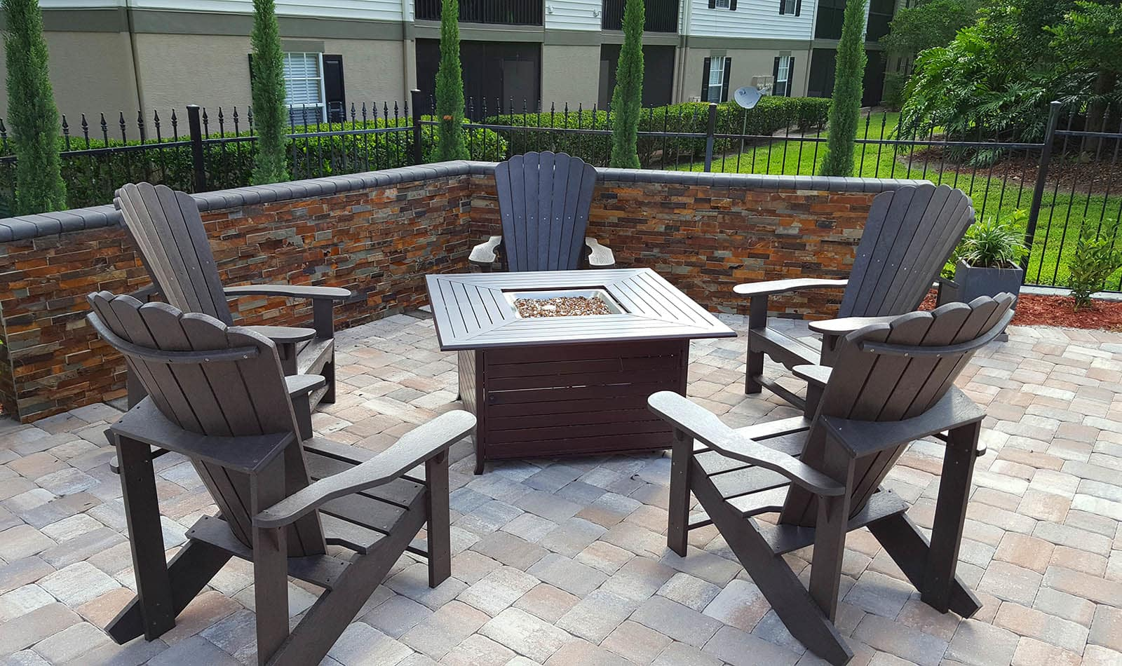 Firepit With Adirondack Chairs at Altamonte at Spring Valley in Altamonte Springs, FL