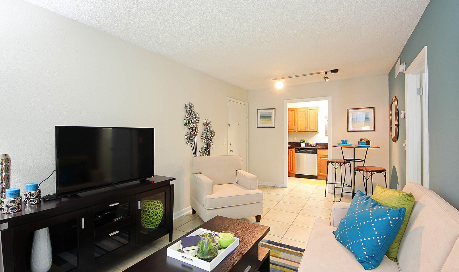Living Room With Flat Screen Tv at Altamonte at Spring Valley in Altamonte Springs, FL