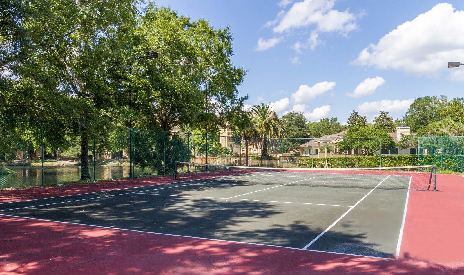 Outdoor Tennis Court in Orange Park Apartments