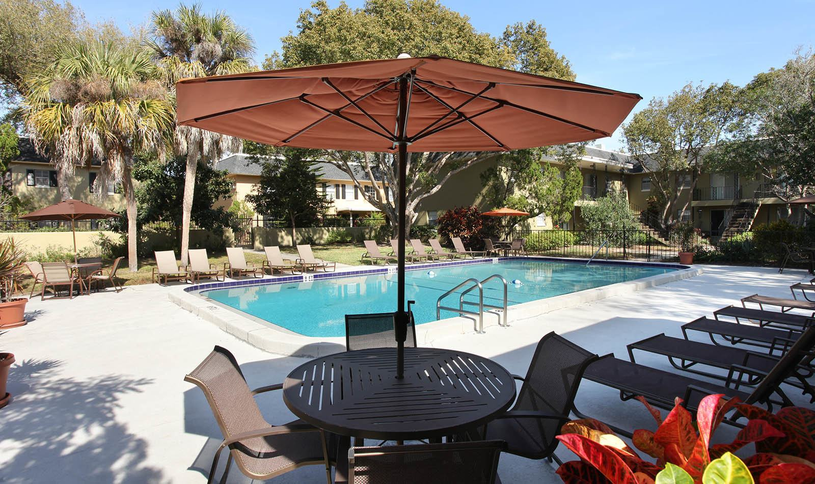 Outdoor pool at apartments in Winter Haven, FL