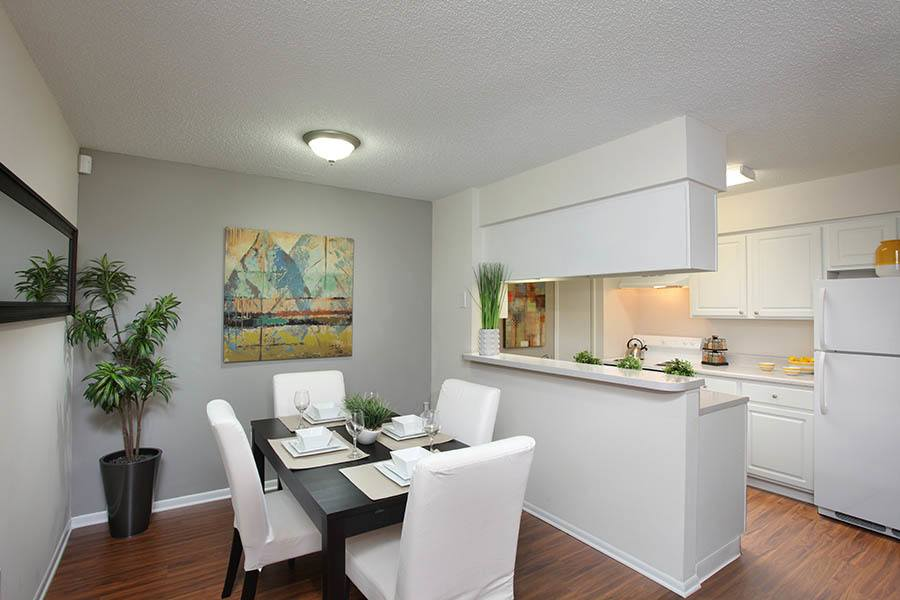 Dining Room And Kitchen at Legend Oaks Apartments in Tampa