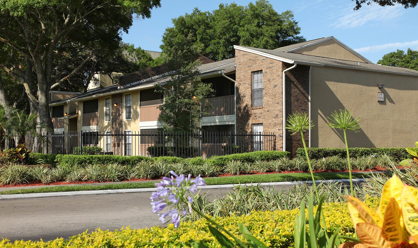 Exterior With Flowers at Legend Oaks Apartments in Tampa