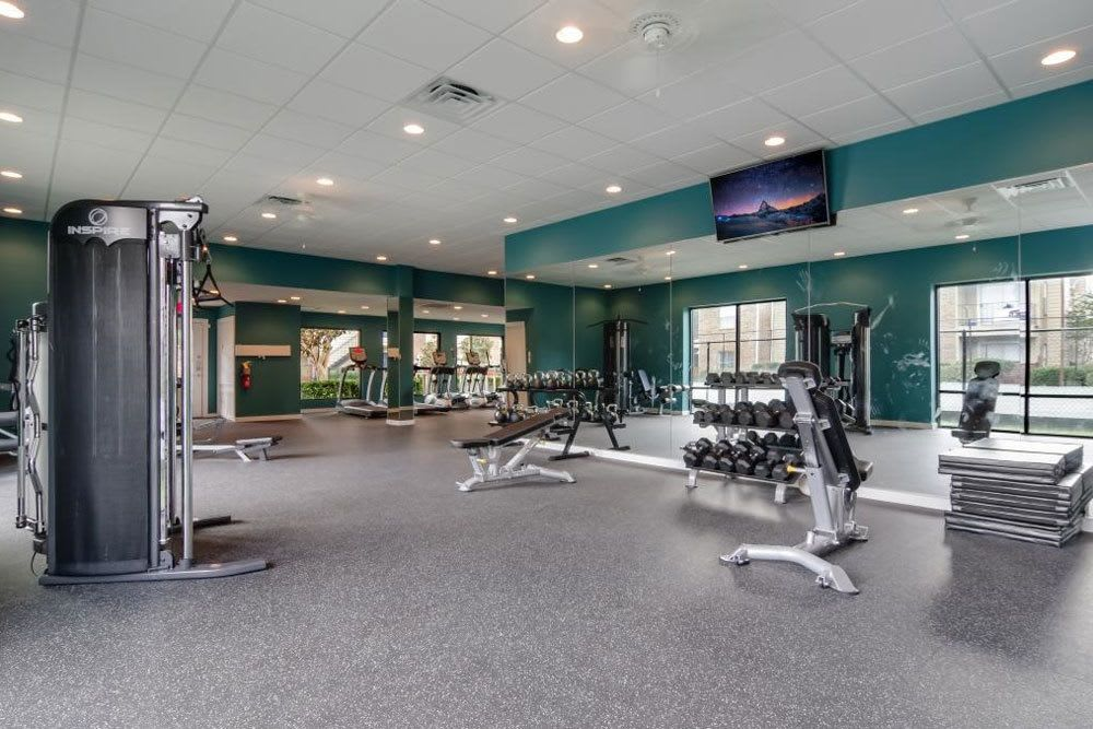 Fitness center at apartments in Katy
