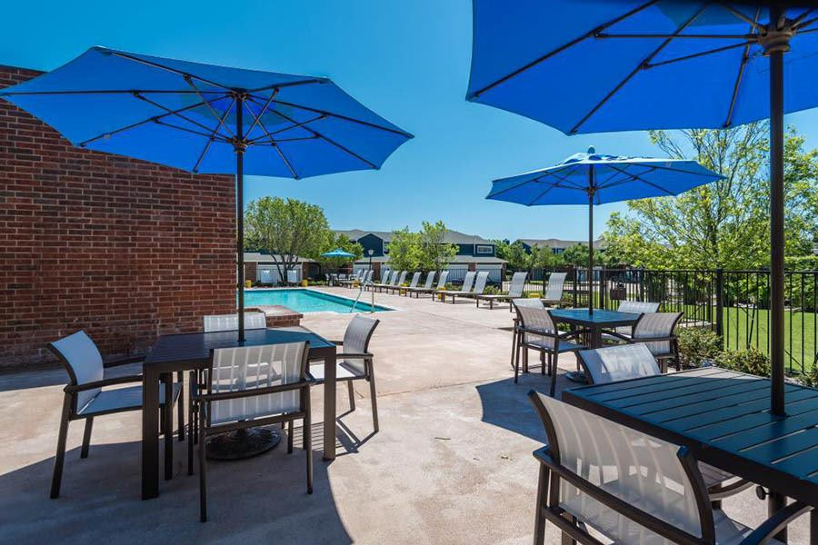 Seating at the pool at apartments in Fort Worth