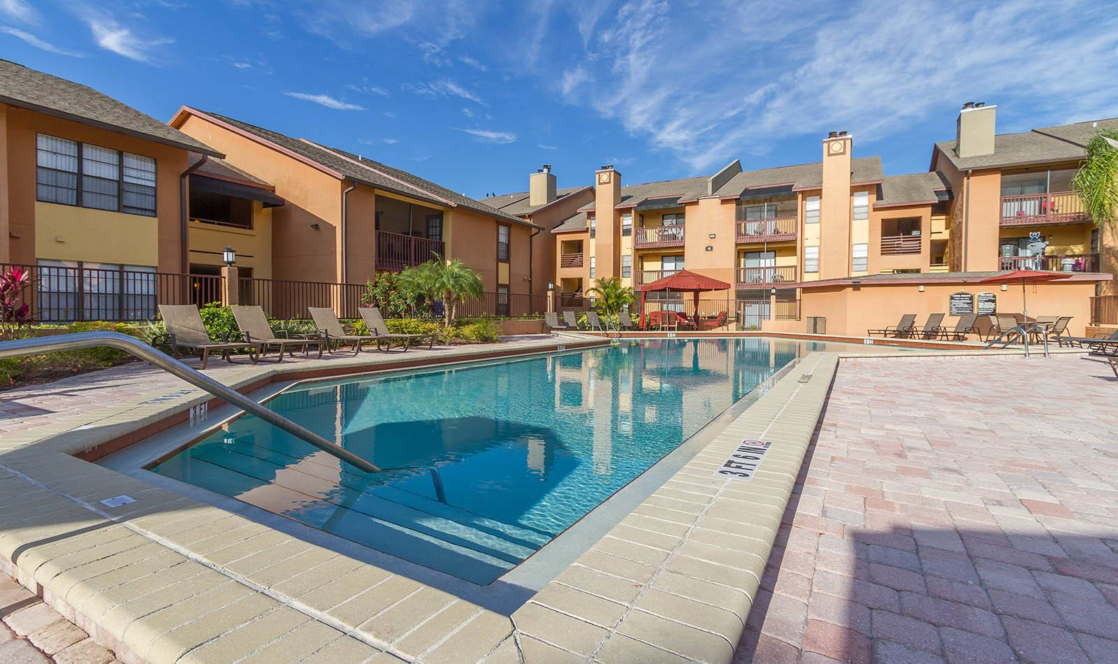 Outdoor pool at Waterstone at Carrollwood Apts in Tampa, FL