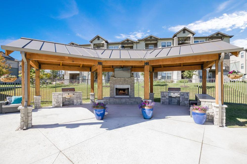 Outdoor fireplace and BBQ at Verandas at Alamo Ranch