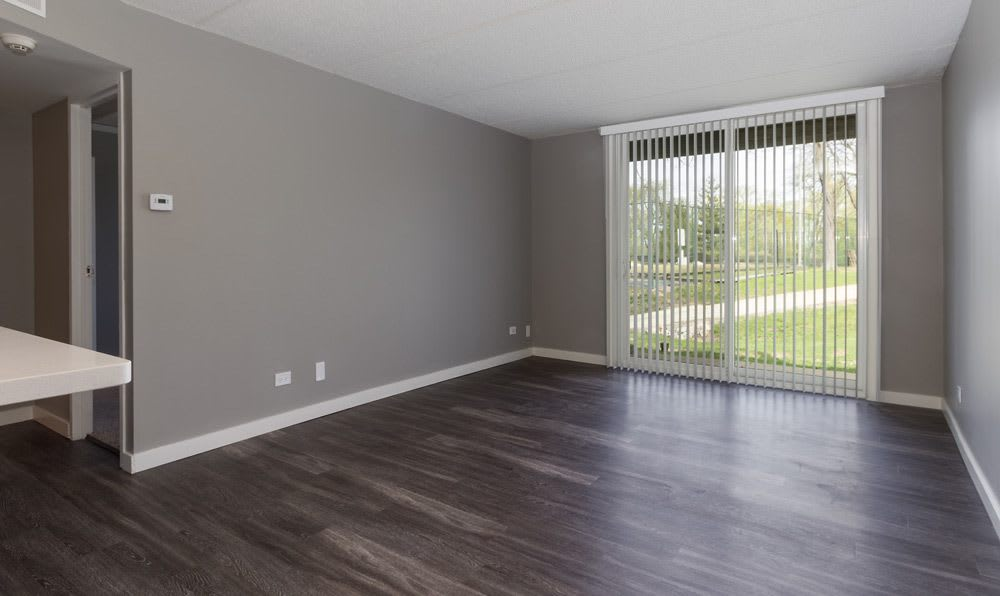 Living room facing sliding glass door at Woodland Ridge Apartments