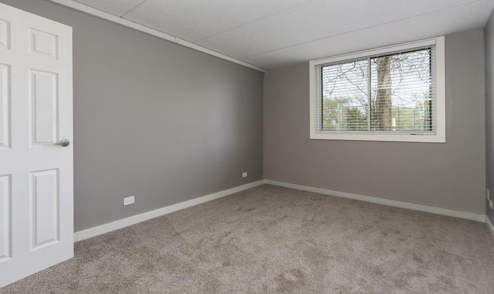 bedroom with window at Woodland Ridge Apartments