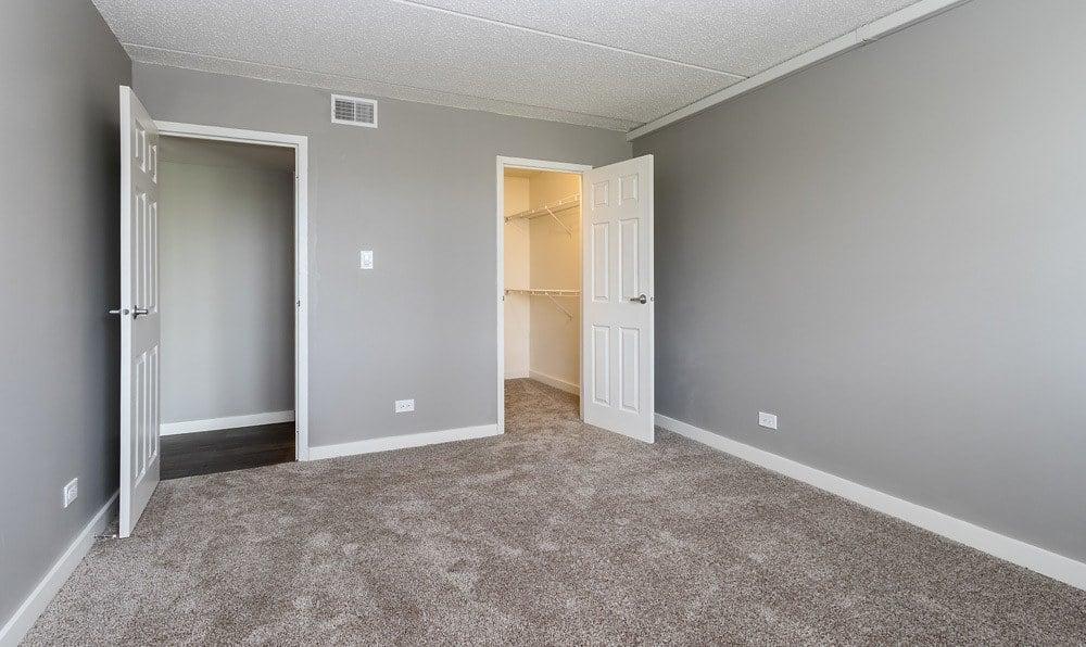 Bedroom and closet at Woodland Ridge Apartments