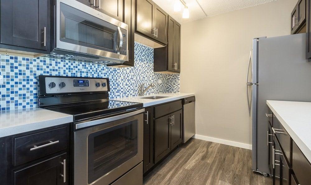 Luxurious kitchen with hardwood floors at Woodland Ridge Apartments
