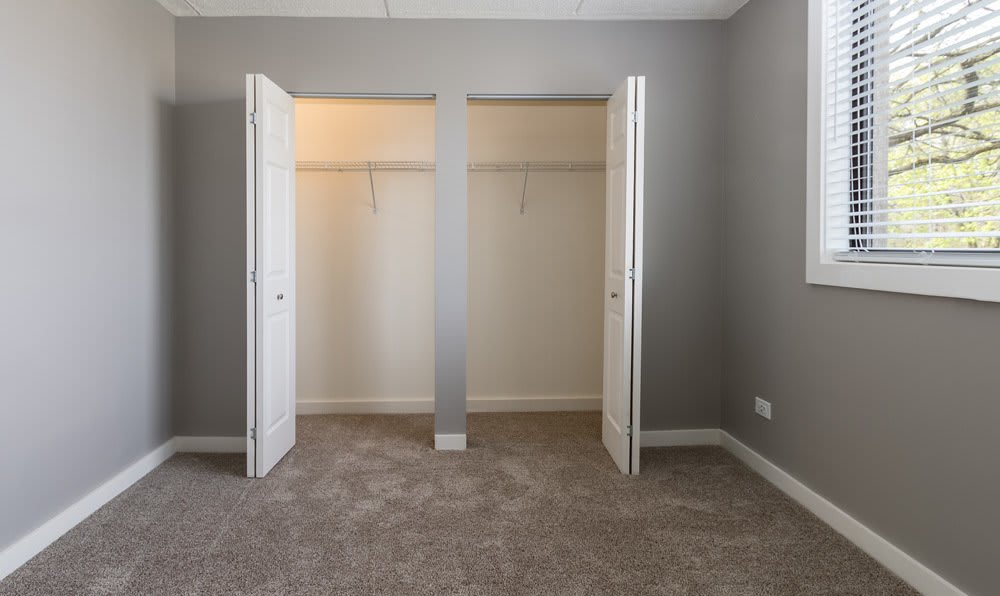 Bedroom with double closet at Woodland Ridge Apartments