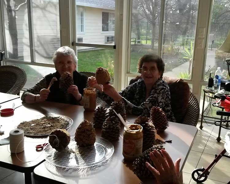 Making bird feeders at Sun Oak Senior Living