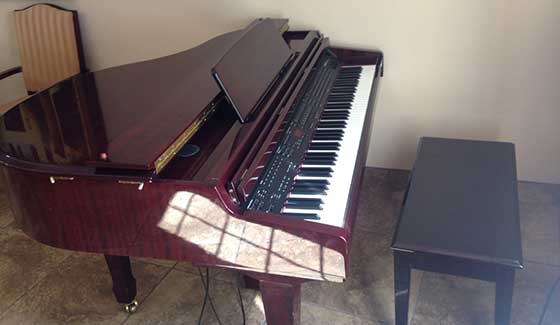 An elegant piano for resident use at Pennington Gardens