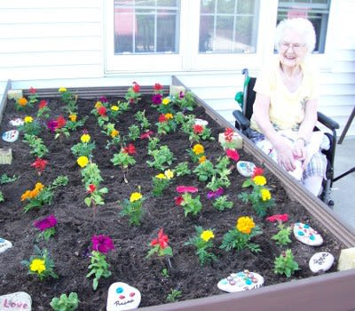 Women enjoying the plants at Marla Vista Assisted Living and Memory Care
