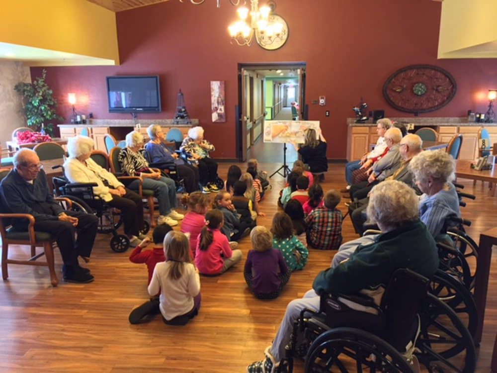 Presentation with grandchildren at Carolina Assisted Living