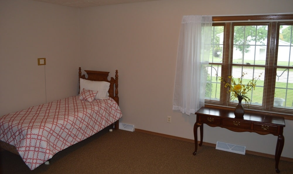 Another view of a bedroom for residents at Carrington Assisted Living