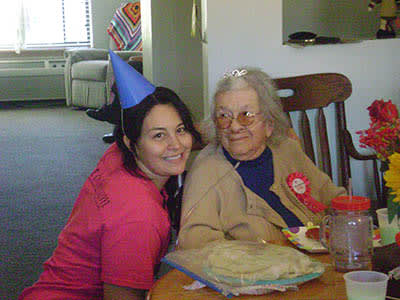 Team member and resident celebrate birthday party