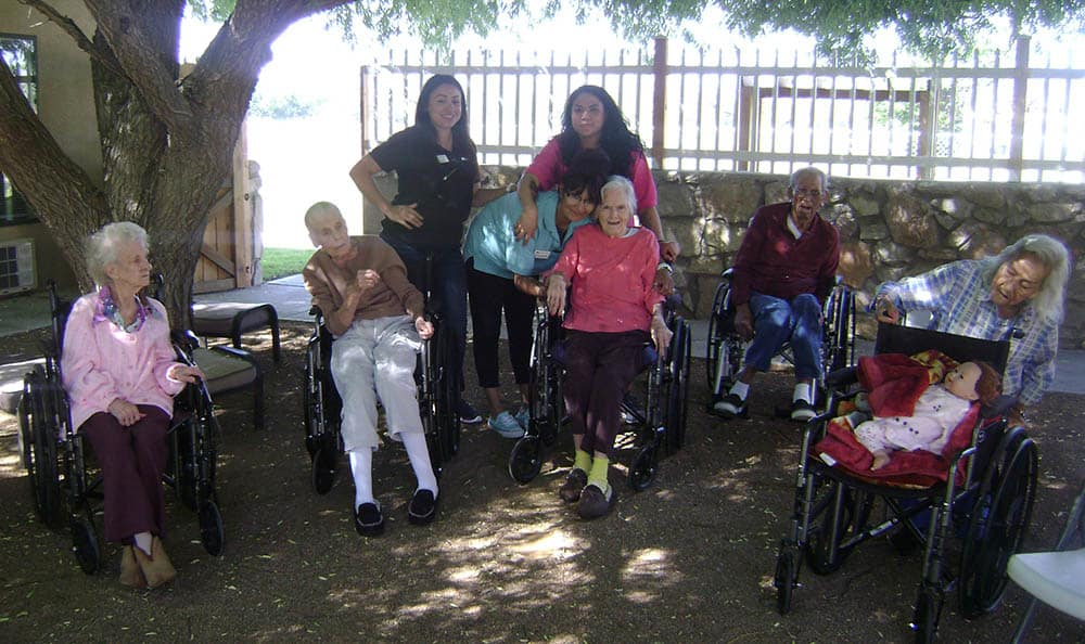 Sitting beneath the tree at Desert Peaks Assisted Living and Memory Care in NM