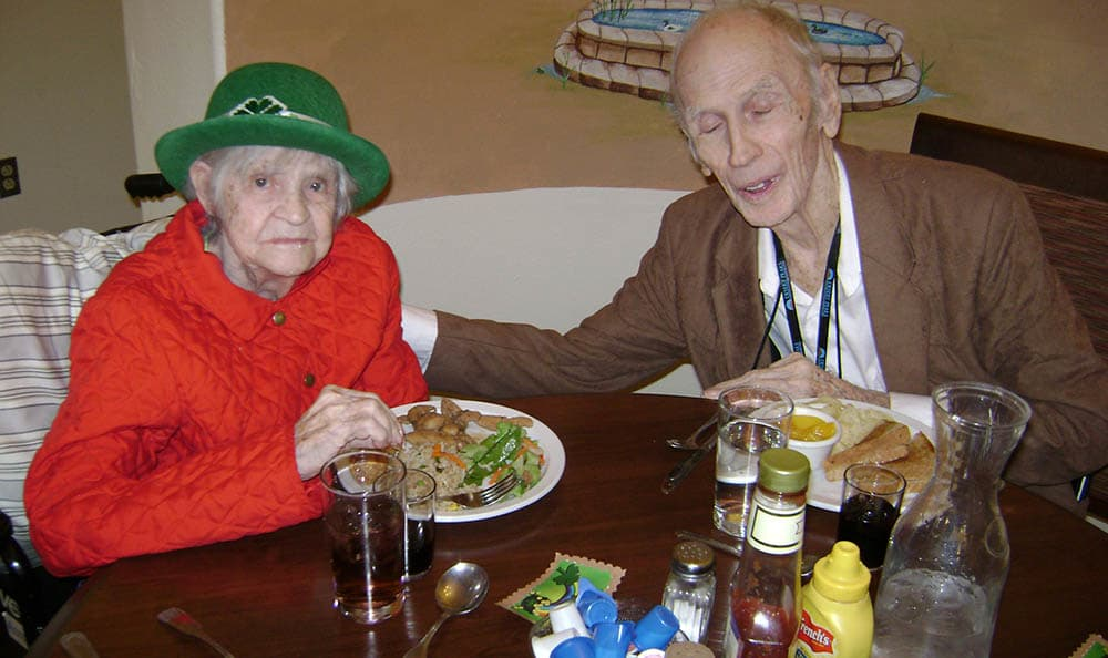Couple eating at Desert Peaks Assisted Living and Memory Care in NM