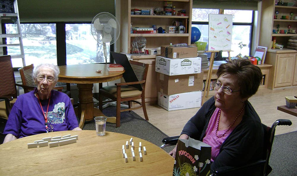 Women playing dominoes at senior living in Las Cruces