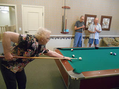 Residents play billiards at Majestic Rim Retirement Living in Payson