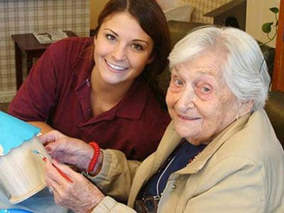 Residents and team member at Sundial Assisted Living