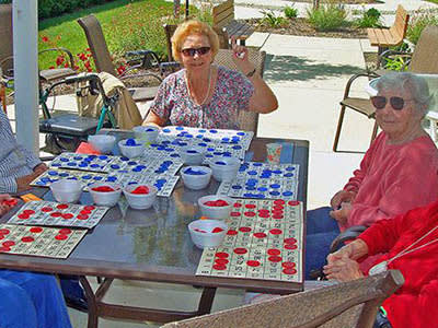 Residents playing bingo on the patio