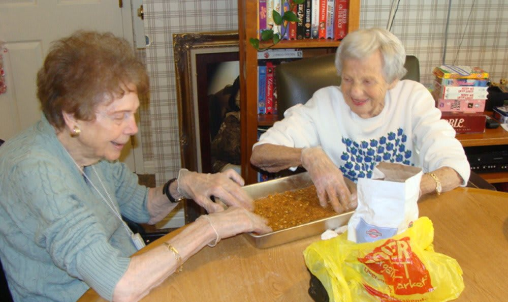 Women cooking at our senior living community