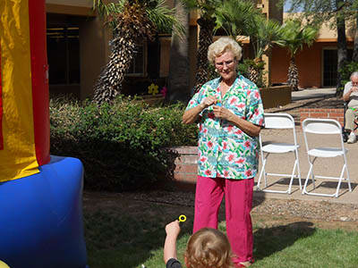 Woman with grandchild at Woodland Palms Memory Care