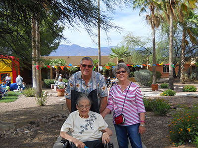 Resident with son and daughters at Woodland Palms Memory Care