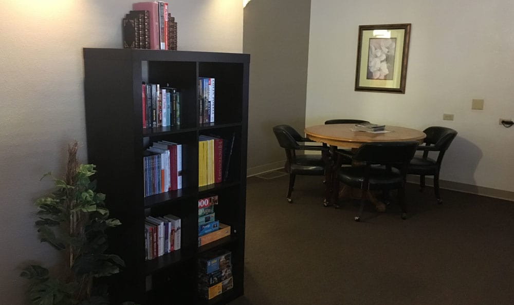 Bookcase at Woodland Palms Memory Care in Tucson, AZ