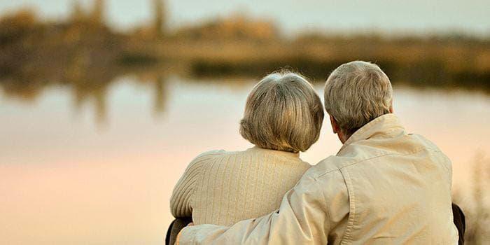 Senior couple looking at the lake