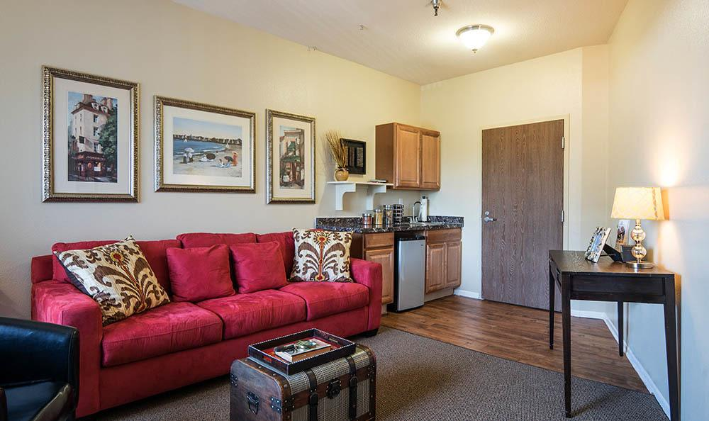 Living room and kitchen in apartment at Carmel Village