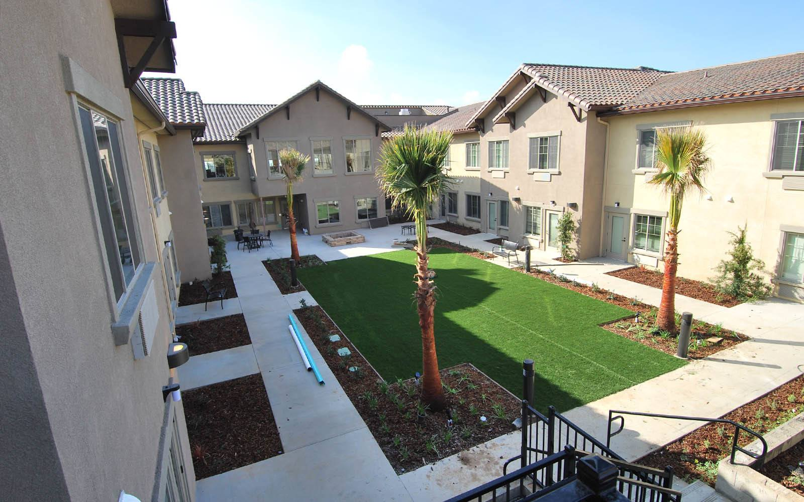 Landscaped Courtyard at Brightwater Senior Living of Highland in Highland, CA