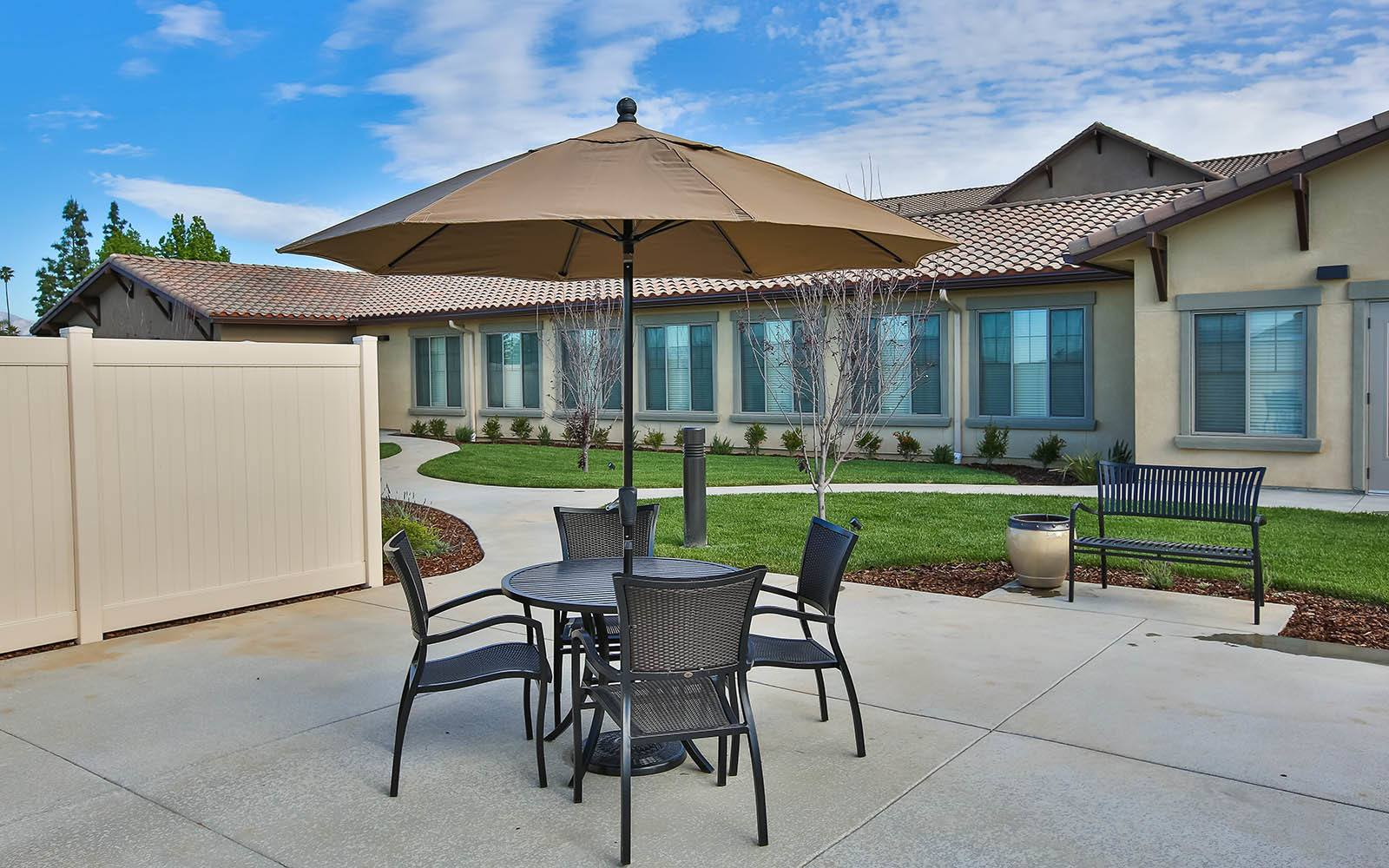 Patio Table With Umbrella at Brightwater Senior Living of Highland in Highland, CA