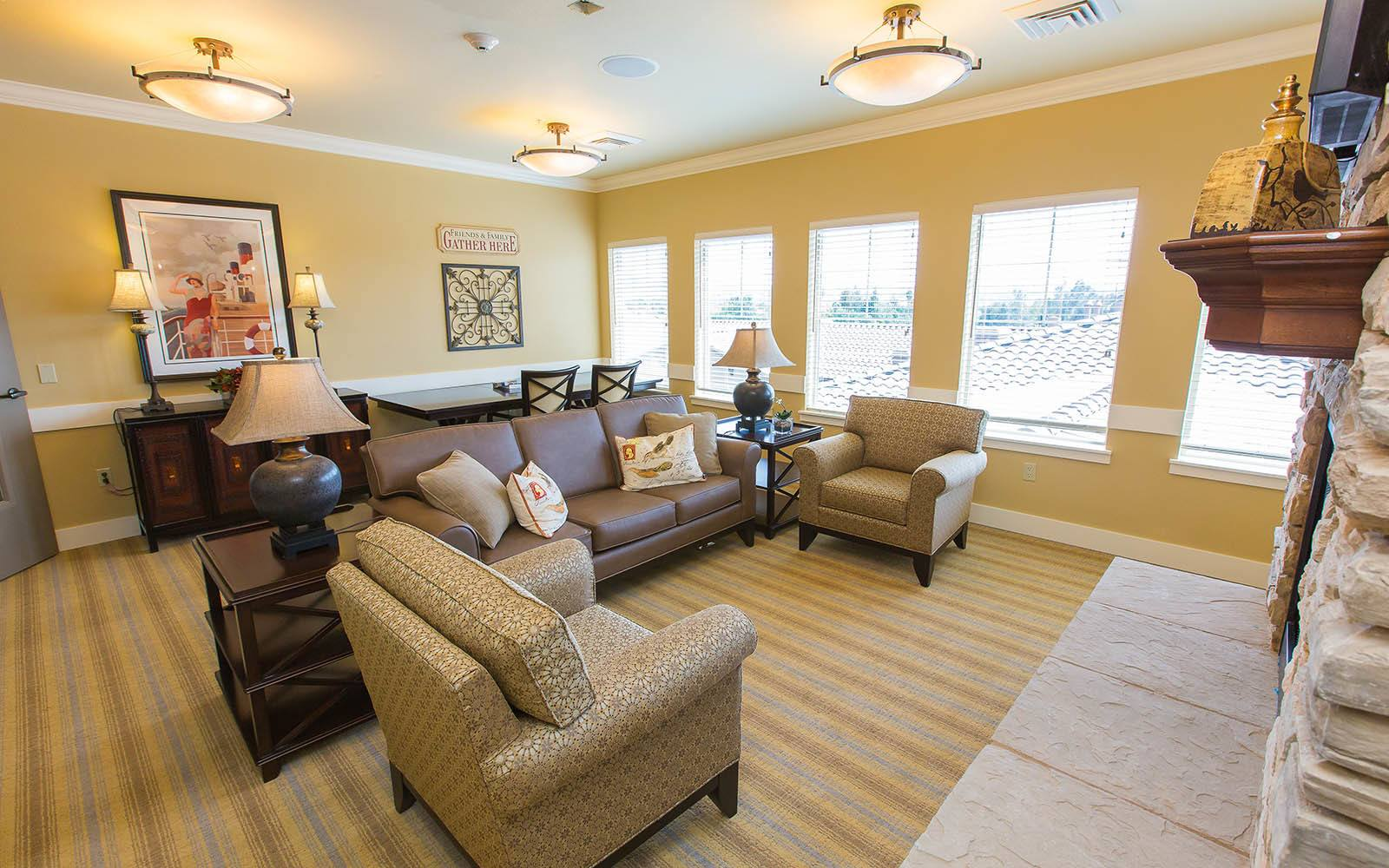 Sitting Room With Comfortable Couch And Chairs at Brightwater Senior Living of Highland in Highland, CA