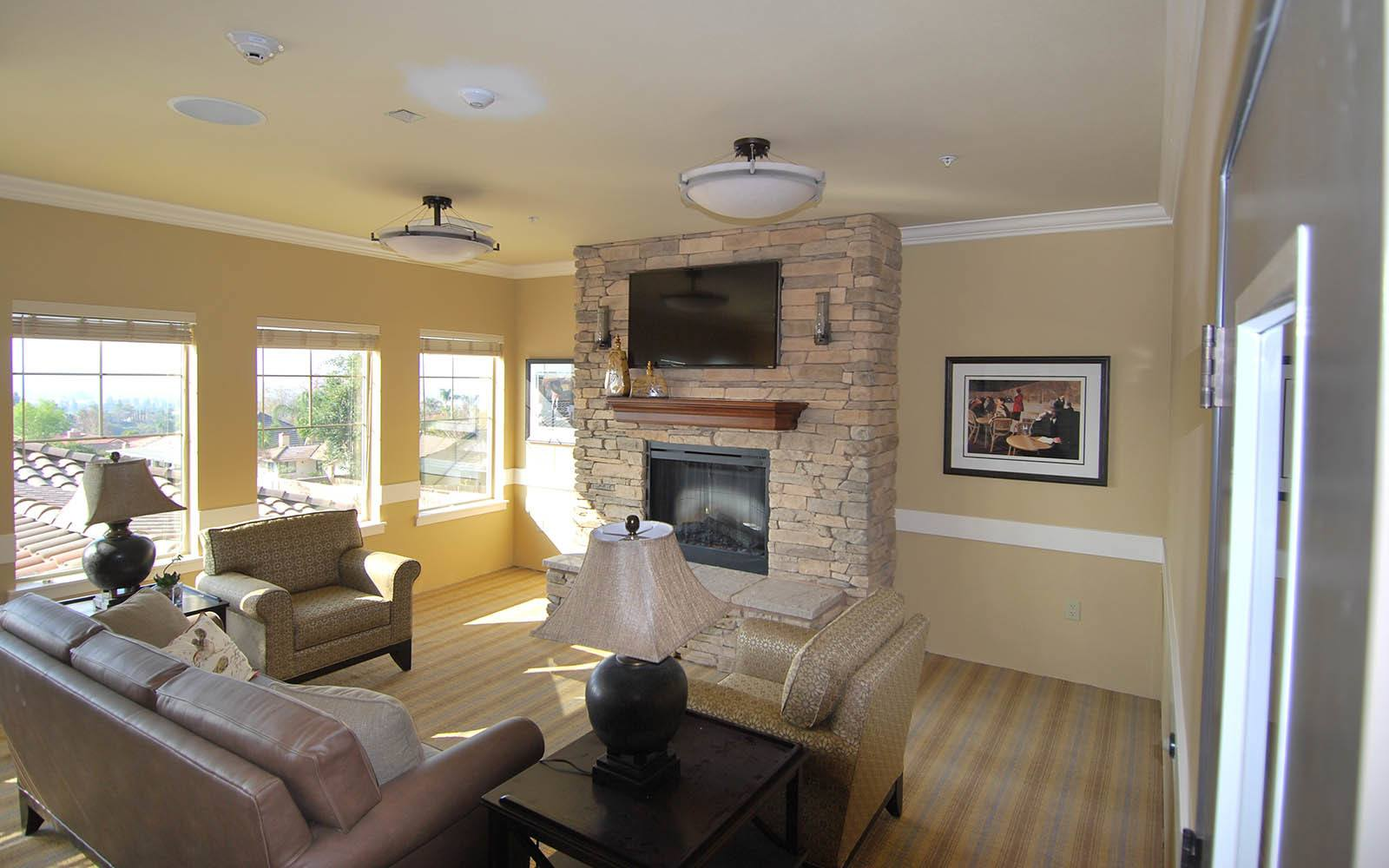 Sitting Room With Tv And Fireplace at Brightwater Senior Living of Highland in Highland, CA
