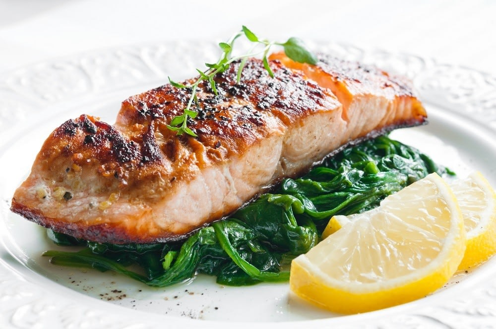 Salmon entree on a bed of greens
