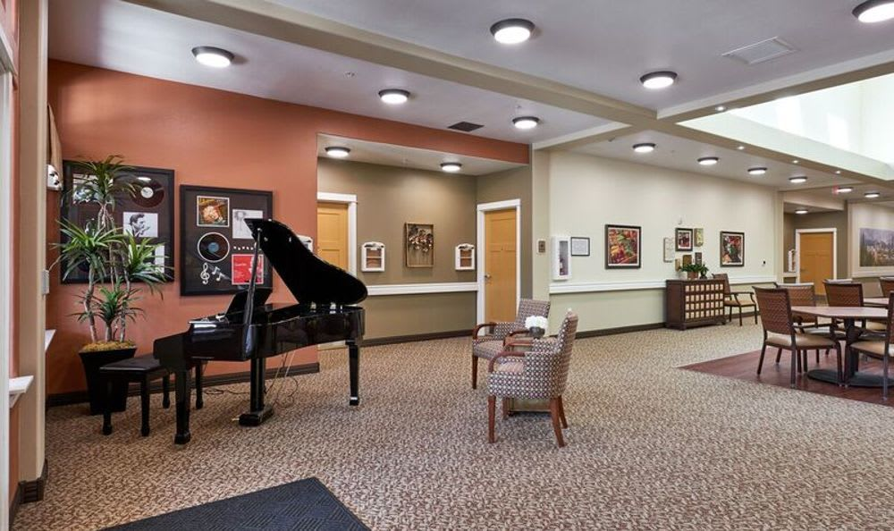 Piano at living room at Sunnyside Meadows Memory Care in Happy Valley, OR