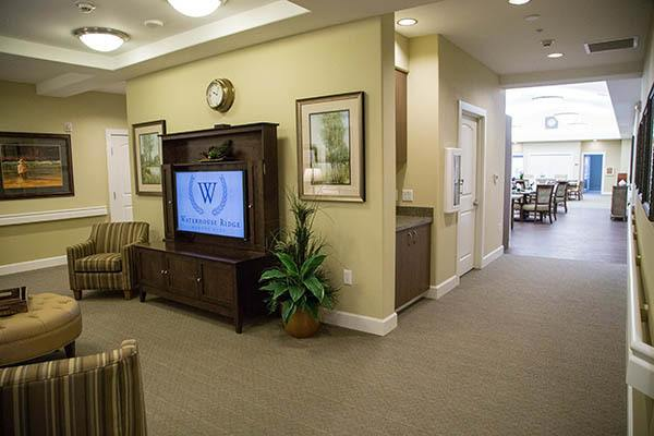 Tv Room Near Dining Room at Waterhouse Ridge Memory Care