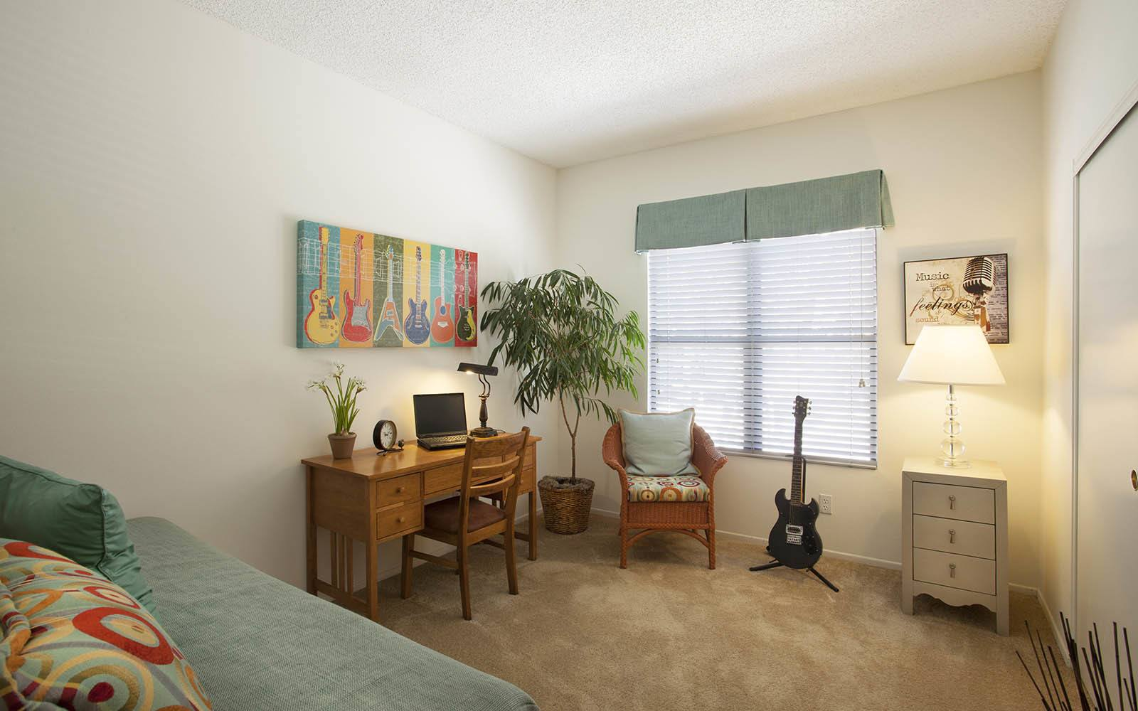 Bedroom With Desk And Extra Floor Space at Cypress Point Apartments in Ventura, CA