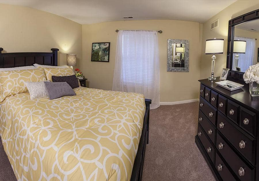 Bedroom at Waltonwood University in Rochester Hills, MI