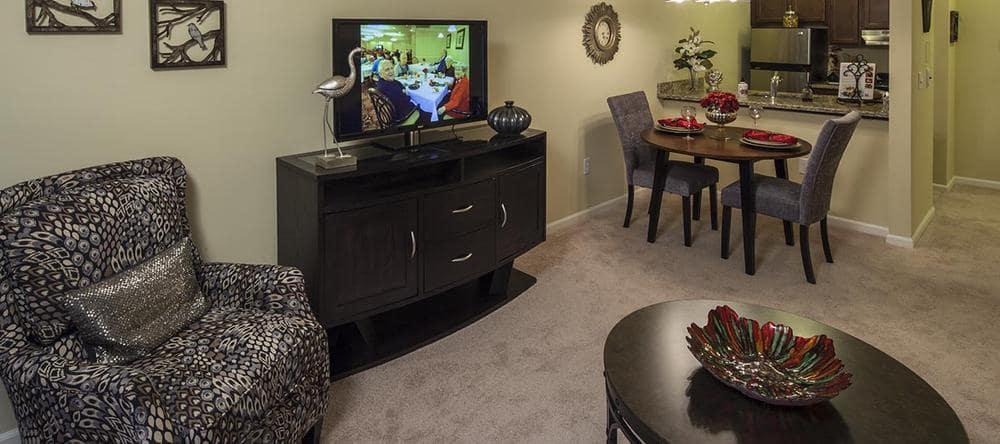 Enjoy cozy living space at Waltonwood University senior apartments