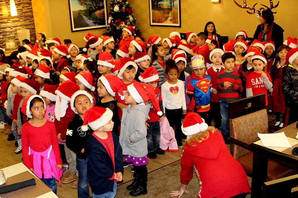 Children Singing Holiday Songs at Merrill Gardens at Santa Maria in Santa Maria