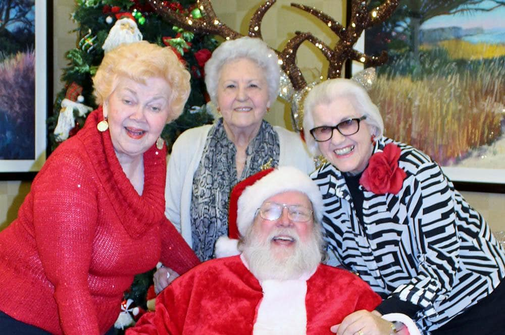 Residents with Santa at Merrill Gardens at Santa Maria