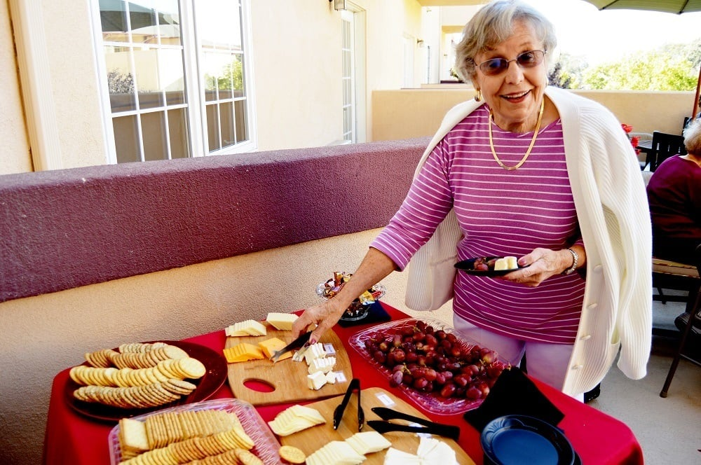 Resident at Merrill Gardens at Santa Maria Enjoying Party Snacks