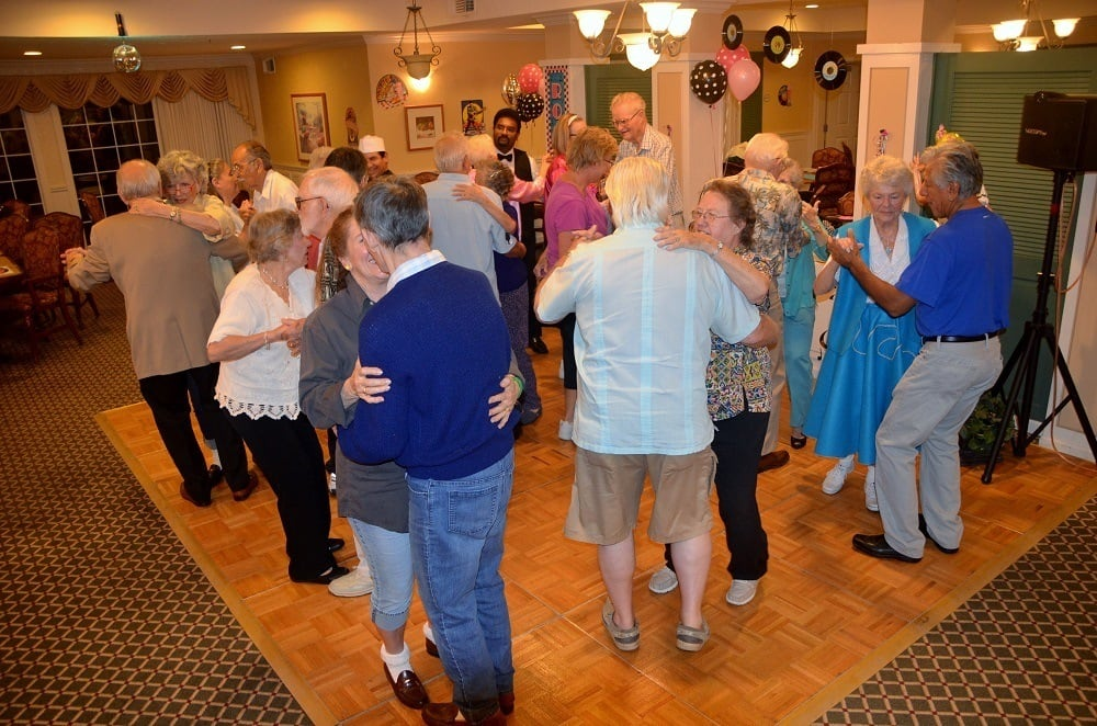 Residents and Guests Dancing at Merrill Gardens at Santa Maria Sock Hop Party in Santa Maria