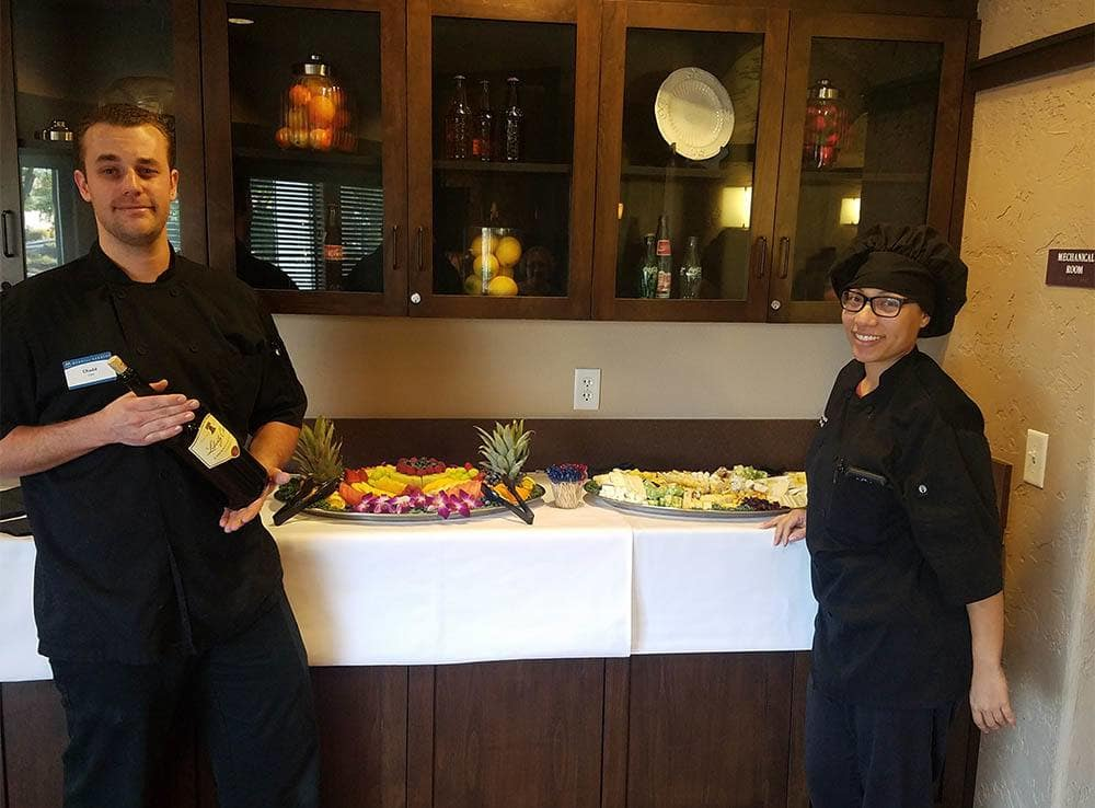 Team members working together on a dining display for upcoming party