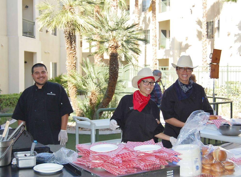 Team members enjoying a BBQ party at our senior living community