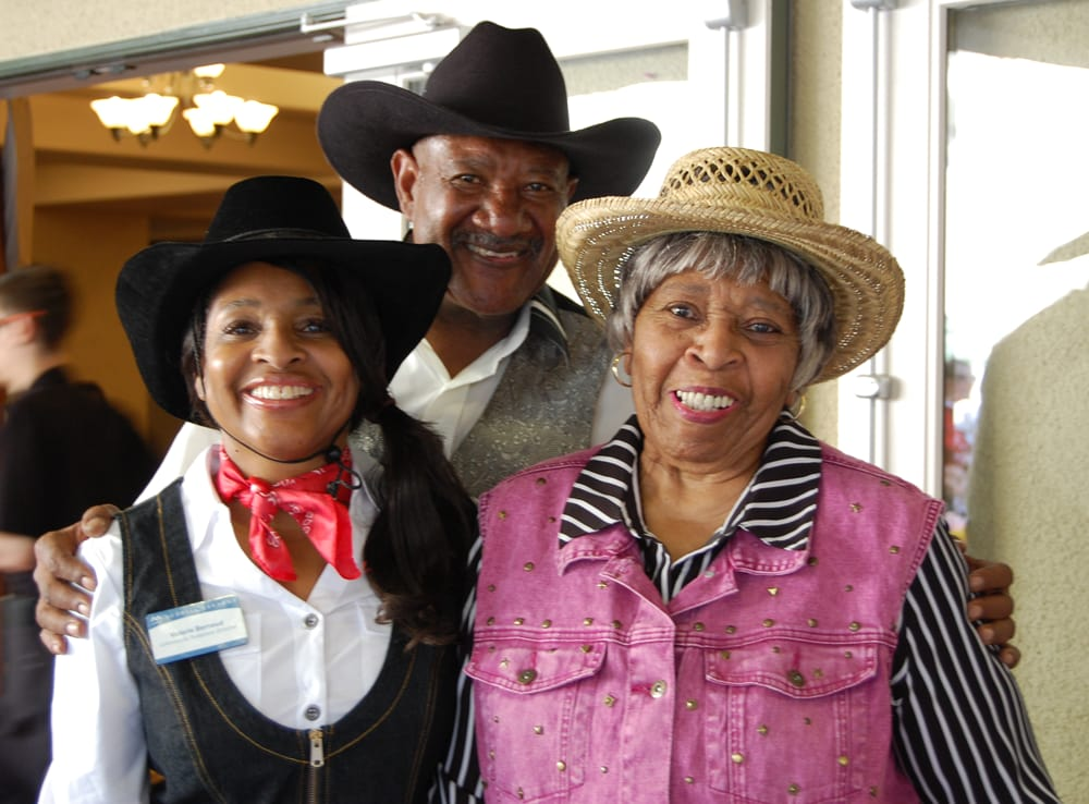 Team members and resident enjoying a western party at MG Green Valley Ranch